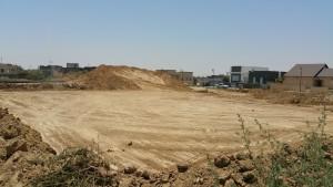 יישור הקרקע לקראת בניית בית פרטי